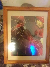 brown wooden framed painting of. Spider man