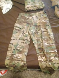 white, green, and brown camouflage cargo pants