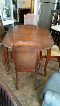 brown wooden table with four chairs Longueuil, J4K 2W6