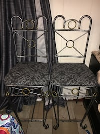 two black metal framed brown padded chairs Waveland, 39576