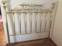 brass-colored bed head grill