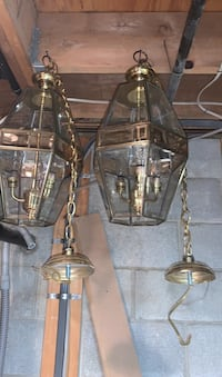 2 glass and brass indoor  hanging chandelier . Beveled glass 6 panel.