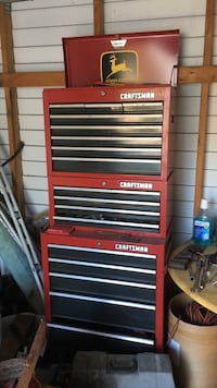red and black Craftsman toolsbox on wheels