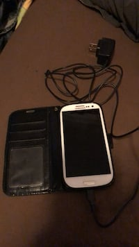 White samsung android smartphone with black case 4804 mi