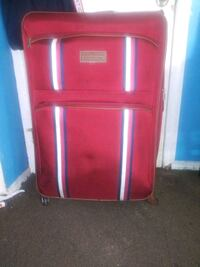 Large Tommy Hilfiger suitcase, 360 Wheel movement  Queens, 11412