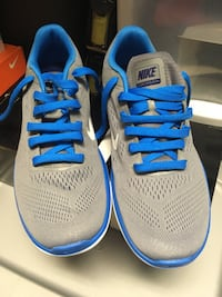 Pair of gray-and-blue nike running shoes Rockville, 20852