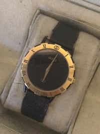 round gold analog watch with black leather strap Kelowna, V1Y 2P9