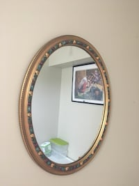 Oval mirror with brown wooden frame Ottawa, K4A 4E7