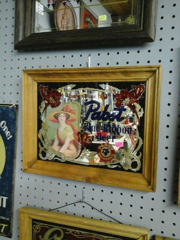 Pabst painting on brown wooden frame
