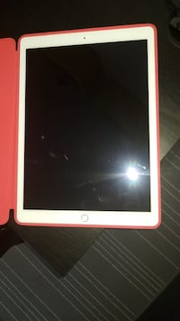 white iPad with red case 789 km