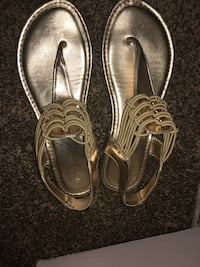 Size 8 women's gold-colored t-strap flat sandals