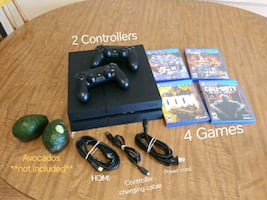 PS4 /w 2 controllers & games