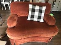 brown suede sofa chair with throw pillow Ocoee, 34734