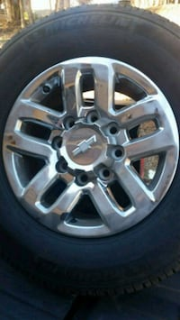 chrome 5-spoke truck wheel with tire