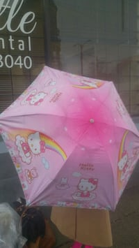 toddler's pink and multicolored Hello Kitty umbrella Vancouver, V5N 1T3