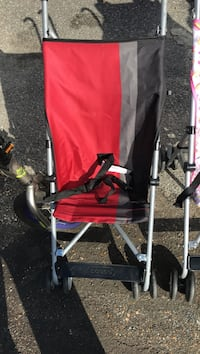 gray, red, and black lightweight stroller