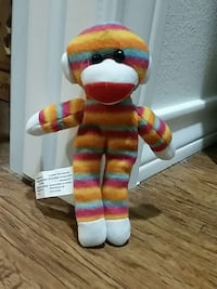 brown, teal, and pink striped monkey plush toy Lubbock, 79415