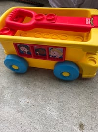 Blue and yellow plastic toy truck and yellow pull lego cart Baltimore