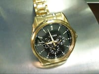 round silver chronograph watch with gold link bracelet Murfreesboro, 37130