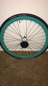 green and black bicycle wheel