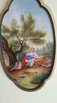 woman and man painting with frame