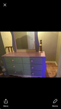 pink and blue wooden dresser with mirror