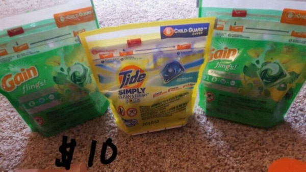 two Gain and Tide detergent packs