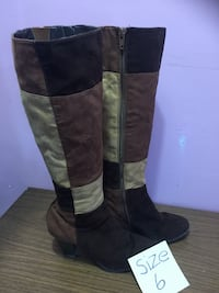 pair of women's brown suede knee-high boots