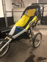 baby's yellow and black jogging stroller Toronto, M4X 1P8