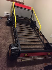 toddler's red, black, and yellow car bed frame Woodinville