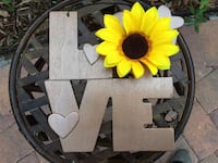 brass-colored love signage with faux yellow sunflower Winter Park, 32789