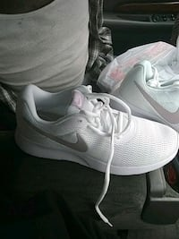 pair of white Nike running shoes Rochester, 55901
