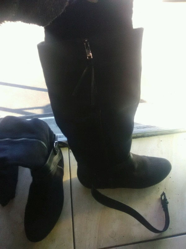 pair of black suede knee high boots 9a22085e-a9c3-4f6c-86f7-d508f459b298