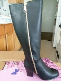 unpaired black leather knee-high chunky boot Fresno, 93725
