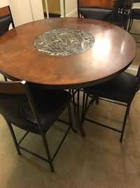 Round brown wooden table with four chairs dining set Lafayette, 70501