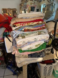 Assorted bed sheets, pillow cases, table cloths, towels $1. To $5.each