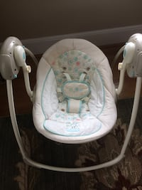 Baby's white and gray swing chair by Bright Starts