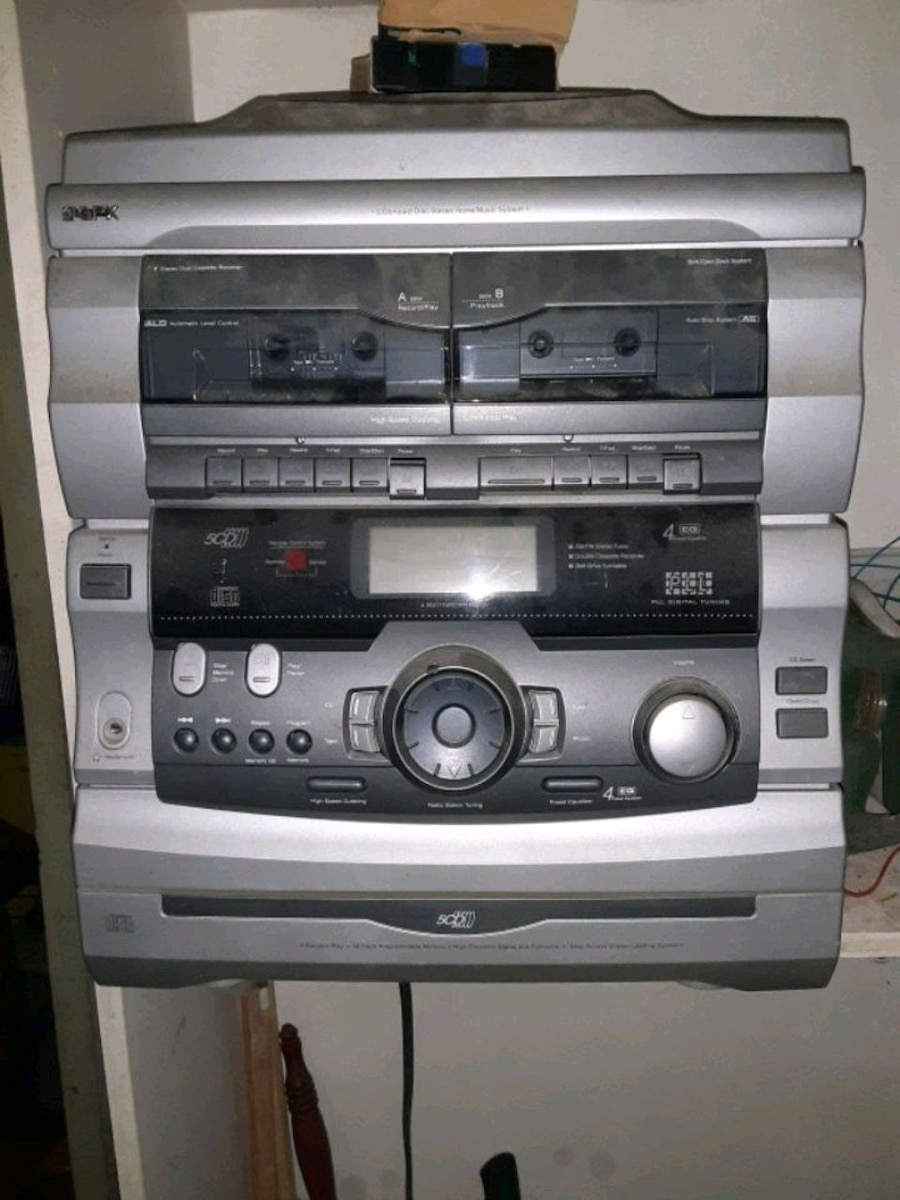 Photo Stereo system, record player, 5 disc CD, and dual cassette