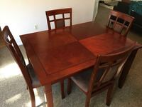 rectangular brown wooden table with four chairs dining set Redlands, 92374