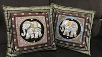 two square elephant print throw pillows, 16 in by 16in