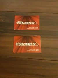 two red EBGames gift cards