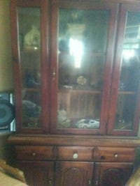 brown wooden framed glass display cabinet Plainville, 30733