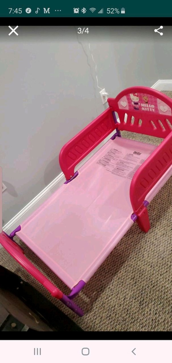 pink and white plastic bed frame