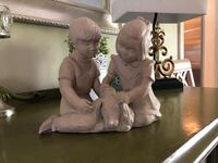 Sculpture of two children and a dog Mc Lean