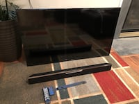 black wooden framed glass top TV stand Fort Belvoir, 22060