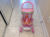 Fisher price  stroller with doll in very good condition Hamilton, L8V 4K6