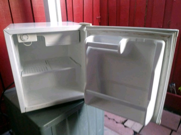 two white and gray plastic containers