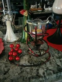 red metal candle rack