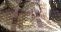 gray and white camouflage backpack Plano, 75074