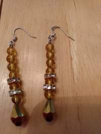 pair of yellow earrings